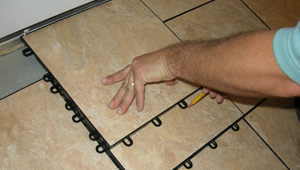 Installing basement floor tiles in a renovated basement