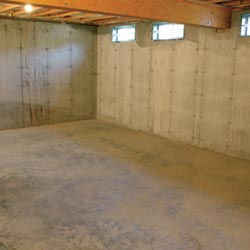 A cleaned out basement in Eugene, shown before remodeling has begun