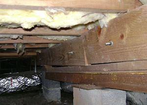 sagging crawl space with wooden shimming a Lake Oswego crawl space