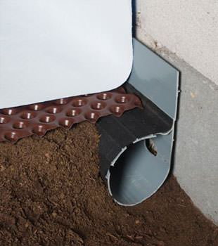 Closeup of a crawl space drainage system installed in Camas