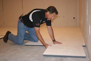 Insulated basement subfloor installation in Vancouver