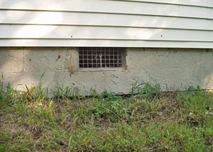Open crawl space vents that let rodents, termites, and other pests in a home in Longview