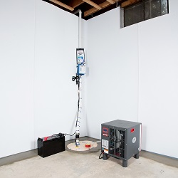 Sump pump system, dehumidifier, and basement wall panels installed during a sump pump installation in Lake Oswego