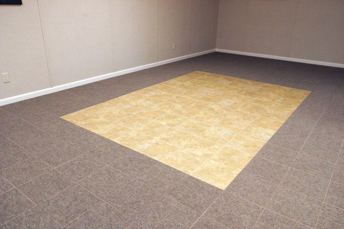 tiled and carpeted basement flooring installed in a Eugene home